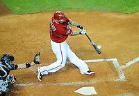 Jun. 1, 2011; Phoenix, AZ, USA; Arizona Diamondbacks batter Ryan Roberts hits a two run home run in the sixth inning against the Florida Marlins at Chase Field. Mandatory Credit: Mark J. Rebilas-