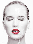 Artistic beauty portrait of a woman face with red lipstick with water running over it. Isolated on white background. Selective black and white. Image © MaximImages, License at https://www.maximimages.com