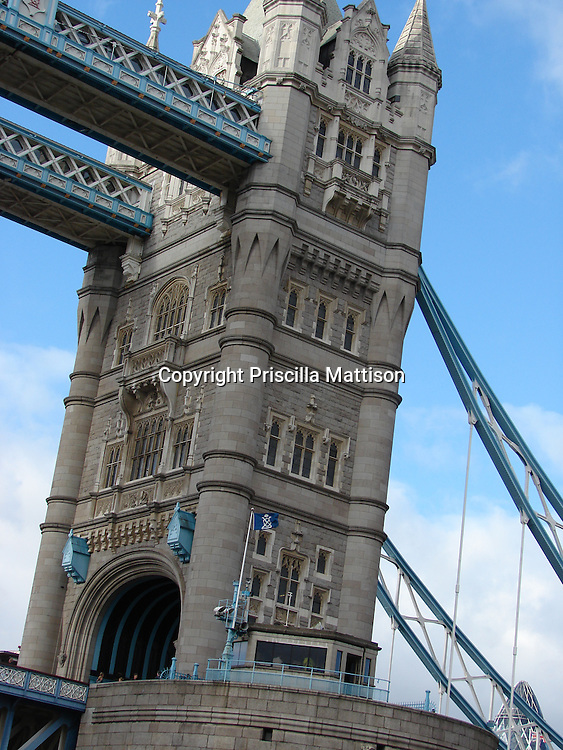 London, England - October 31, 2006:  One of two towers of Tower Bridge looms nearby.