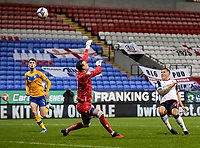 Bolton Wanderers' Antoni Sarcevic beats Mansfield Town's goalkeeper Marek Stech to score his side's first goal <br /> <br /> Photographer Andrew Kearns/CameraSport<br /> <br /> The EFL Sky Bet League Two - Bolton Wanderers v Mansfield Town - Tuesday 3rd November 2020 - University of Bolton Stadium - Bolton<br /> <br /> World Copyright © 2020 CameraSport. All rights reserved. 43 Linden Ave. Countesthorpe. Leicester. England. LE8 5PG - Tel: +44 (0) 116 277 4147 - admin@camerasport.com - www.camerasport.com