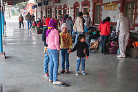 India, Dehradun.  Young Girls on the Platform at the Train Station.