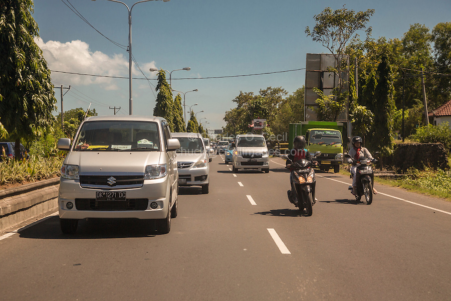 Bali, Indonesia.  Highway Traffic between Denpasar and Semarapura.