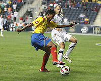 Jermaine Jones #15 of the USA MNT closes down Juan Cuadrano #4 of Colombia during an international friendly match at PPL Park, on October 12 2010 in Chester, PA. The game ended in a 0-0 tie.