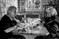Switzerland. Canton Geneva. Chambésy. Claude Ruef (L) and her friend Pierrette Thomas (R) enjoy their lunch. They sit in the kitchen room. 4.03.2020  © 2020 Didier Ruef