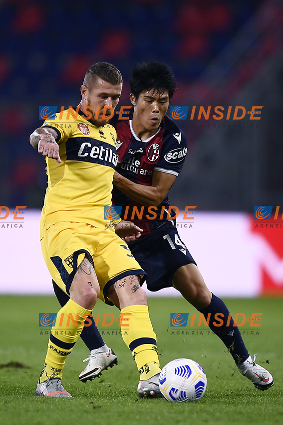 Jurai Kucka-Takehiro Tomiyasu <br /> during the Serie A football match between Bologna FC and Parma Calcio 1913 at stadio Renato Dall Ara in Bologna (Italy), September 28th, 2020. Photo Image Sport / Insidefoto