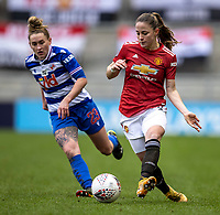 7th February 2021; Leigh Sports Village, Lancashire, England; Women's English Super League, Manchester United Women versus Reading Women; Ella Toone of Manchester United Women passes through the middle under pressure from Rachel Rowe of Reading