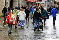 A man carries a huge Santa bag as he joins other last minute Christmas shoppers in Oxford Street, in the city centre of Swansea, Wales, UK. Sunday 24 December 2017