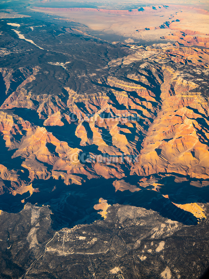 South Rim, Grand Canyon in winter from a window seat on a United Airlines flight from Chicago to Los Angeles over America's Flyover County.
