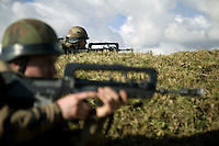 Members of the French Foreign Legion hold their positions during a full scale multi-force exercise held at the airport of Tarbes, France, 11 December 2007.