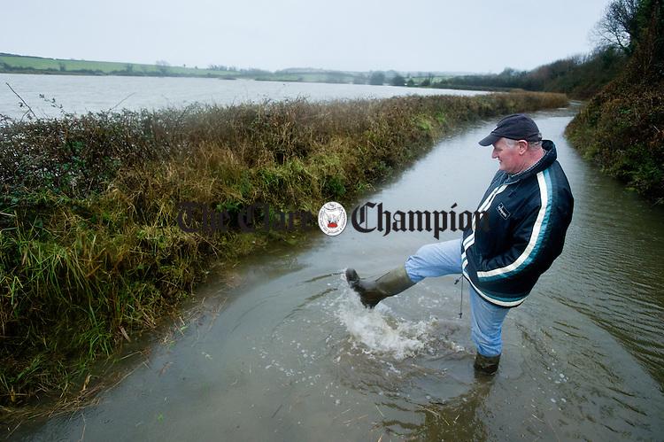 Farmer Tom Finn at the entrance to his farm at Lacknashannagh, Kildysart on the Shannon Estuary, where he has 22 acres of grazing and meadow under severe flood. Photograph by John Kelly.