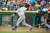 Humberto Quintero (35) of the Tacoma Rainiers at bat against the Salt Lake Bees in Pacific Coast League action at Smith's Ballpark on July 8, 2014 in Salt Lake City, Utah.  (Stephen Smith/Four Seam Images)