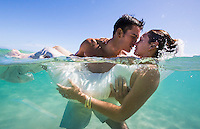 """Trash the Dress"" photo shoot in the ocean with recently married couple Seth and Markee in Hau'ula, O'ahu."