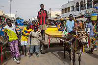 Senegal, Touba.  Young Men on a Busy Market Street.