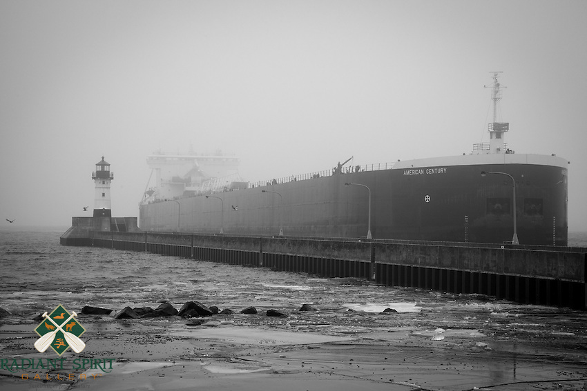 """""""Emerging""""<br /> The American Century, a """"thousand footer"""", emerges through Lake Superior's fog in December."""