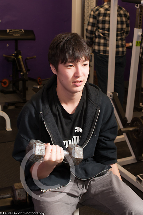 Education High School physical education elective weight lifting boy lifting weights