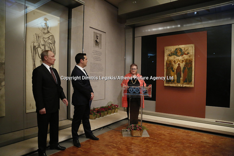 Pictured: Vladimir Putin and Alexis Tsipras are introduced by a museum representative Friday 27 May 2016<br />Re: Russian President Vladimir Putin with Greek Prime Minister Alexis Tsipras at the exhibition opening 'Ascension of the Christ' at the Byzantine Museum, Athens, Greece