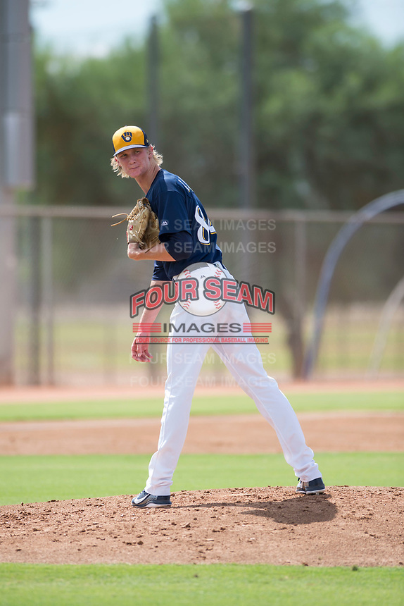 Milwaukee Brewers relief pitcher Caden Lemons (84) checks the runner at first base during an Instructional League game against the Los Angeles Dodgers at Maryvale Baseball Park on September 24, 2018 in Phoenix, Arizona. (Zachary Lucy/Four Seam Images)