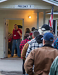CRAWFORDVILLE, FL - NOVEMBER 03: A precinct 7 poll workers signals for two more voters as they stand in line for the polls to open on November 3, 2020 in Crawfordville, United States.  After a record-breaking early voting turnout, Americans head to the polls on the last day to cast their vote for incumbent U.S. President Donald Trump or Democratic nominee Joe Biden in the 2020 presidential election. (Photo by Mark Wallheiser/Getty Images)