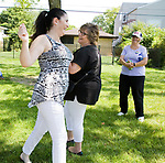 """Janine Foy Witko and a neighbor dance to """"It's a Wonderful World"""" during the Family Peace Fest for Hope and Harmony, in Morton Grove, Saturday, August 19, 2017. [Photo by Karen Kring]"""