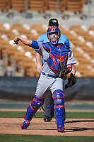 Mesa Solar Sox catcher Victor Caratini (3), of the Chicago Cubs organization, throws to first base during a game against the Glendale Desert Dogs on October 20, 2016 at Camelback Ranch in Glendale, Arizona.  Glendale defeated Mesa 3-2.  (Mike Janes/Four Seam Images)