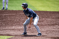 Liberty Flames left fielder Aaron Anderson (9) leads off first base against the Duke Blue Devils in NCAA Regional play on Robert M. Lindsay Field at Lindsey Nelson Stadium on June 4, 2021, in Knoxville, Tennessee. (Danny Parker/Four Seam Images)