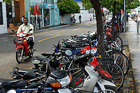 Parked scooters and motorbikes on the street in Male, Maldives.