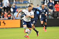 KANSAS CITY, KS - MAY 16: Lucas Cavallini #9 Vancouver Whitecaps with the ball during a game between Vancouver Whitecaps and Sporting Kansas City at Children's Mercy Park on May 16, 2021 in Kansas City, Kansas.