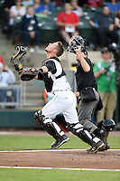 Dayton Dragons catcher Mitch Trees (10) looks for a popup in front of umpire Brandin Sheeler during a game against the South Bend Cubs on May 11, 2016 at Fifth Third Field in Dayton, Ohio.  South Bend defeated Dayton 2-0.  (Mike Janes/Four Seam Images)