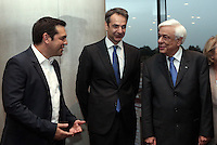 Pictured L-R: Prime Minister Alexis Tsipras, New Democracy leader Kyriakos Mitsotakis and Greek President Prokopis Pavlopoulos at a formal dinner in Athens, Greece. Friday 17 June 2016<br /> Re: The United Nations secretary-general is visiting Greece, ahead of talks with government officials and a trip to the island of Lesbos, which is at the forefront of Greece's immigration crisis.<br /> Ban Ki-moon met with officials and volunteers at the Solidarity Now group, which helps victims of Greece's financial crisis and migrants stuck in the country.<br /> He has also visited Greek President Procopis Pavlopoulos before travelling camps on Lesbos island where 3,400 refugees and other migrants live.