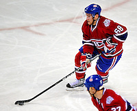 22 April 2009: Montreal Canadiens' defenseman Yannick Weber from Switzerland brings the puck out of his end during the third period against the Boston Bruins at the Bell Centre in Montreal, Quebec, Canada. The Bruins advanced to the Eastern Semi-Finals, eliminating the Canadiens from Stanley Cup competition with a 4-1 win and series sweep. ***** Editorial Sales Only ***** Mandatory Credit: Ed Wolfstein Photo