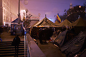 """Kiev, Ukraine.December 27, 2004..Tents set along Kreshatik, the central street in Kiev where demonstrators lived for nearly a month to overturn what they felt was a rigged election. In a second round of voting the polls show Viktor Yushchenko, the opposition candidate, in a strong lead over Viktor Yanukovich with 98% of the vote counted...The first round of voting was considered fraudulent when the ruling president Viktor Yahukovich won and the opposition candidate Viktor Yushchenko lost. ..Several hundred thousand Ukrainians took to the streets of Kiev and held daily rallies on Maidan Independence Square. The protests lasted nearly a month before the first vote was declared invalid and a new round of elections held on December 26, 2004. ..The demonstrations would come to be known as the """"Orange Revolution"""" after the color of the opposition party."""