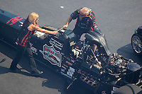 Sep 17, 2016; Concord, NC, USA; Crew members with NHRA top fuel driver Scott Palmer during qualifying for the Carolina Nationals at zMax Dragway. Mandatory Credit: Mark J. Rebilas-USA TODAY Sports