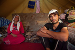 DOMIZ, IRAQ: Fadhi, a Syrian refugee, and one of his two wives in the Domiz refugee camp..Over 7,000 Syrian Kurds have fled the violence in Syria and are living in the Domiz refugee camp in the semi-autonomous region of Iraqi Kurdistan...Photo by Ali Arkady/Metrography