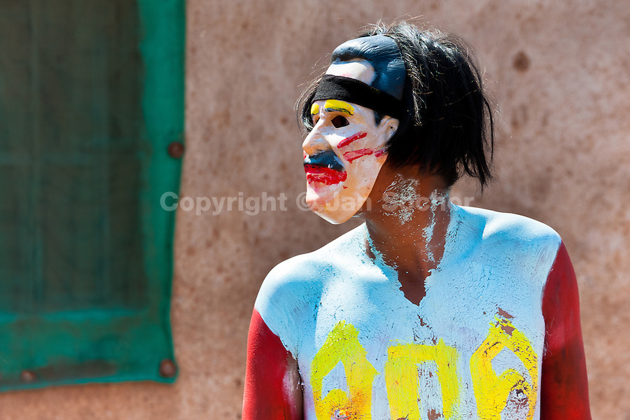 """A Cora Indian man, wearing a colorful mask, takes a part in the religious ritual ceremony of Semana Santa (Holy Week) in Jesús María, Nayarit, Mexico, 22 April 2011. The annual week-long Easter festivity (called """"La Judea""""), performed in the rugged mountain country of Sierra del Nayar, merges indigenous tradition (agricultural cycle and the regeneration of life worshipping) and animistic beliefs with the Christian dogma. Each year in the spring, the Cora villages are taken over by hundreds of wildly running men. Painted all over their semi-naked bodies, fighting ritual battles with wooden swords and dancing crazily, they perform demons (the evil) that metaphorically chase Jesus Christ, kill him, but finally fail due to his resurrection. La Judea, the Holy Week sacred spectacle, represents the most truthful expression of the Coras' culture, religiosity and identity."""