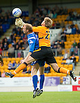 St Johnstone v Bolton....02.08.10  Pre-Season Friendly.Jussi Jaaskelainen and Steven Anderson battle for the ball.Picture by Graeme Hart..Copyright Perthshire Picture Agency.Tel: 01738 623350  Mobile: 07990 594431
