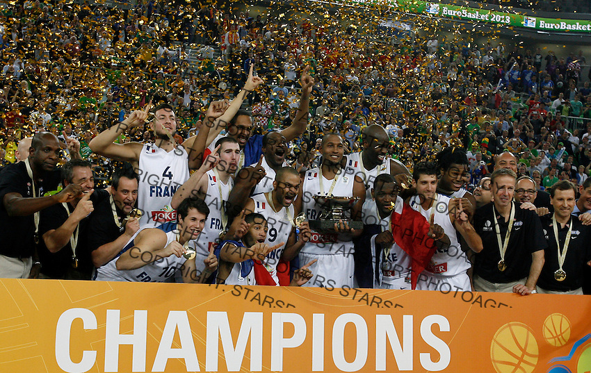 "France`s national basketball team players Joffrey Lauvergne, Nicolas Batum, Antoine Diot, Johan Petro, Charles Kahudi, Thomas Heurtel, Florent Pietrus, Tony Parker, Nando De Colo, Bors Diaw, Alexis Ajinca, Mickael Gelabale and France`s national basketball team head coach Vincent Collet celebrate victory and firsth place after European basketball championship ""Eurobasket 2013""  final game between France and Lithuania in Stozice Arena in Ljubljana, Slovenia, on September 22. 2013. (credit: Pedja Milosavljevic  / thepedja@gmail.com / +381641260959)"