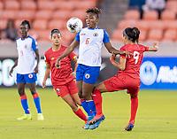 HOUSTON, TX - FEBRUARY 3: Melchie Dumonay #6 of Haiti dribbles past Amarelis De Mera #9 of Panama during a game between Panama and Haiti at BBVA Stadium on February 3, 2020 in Houston, Texas.