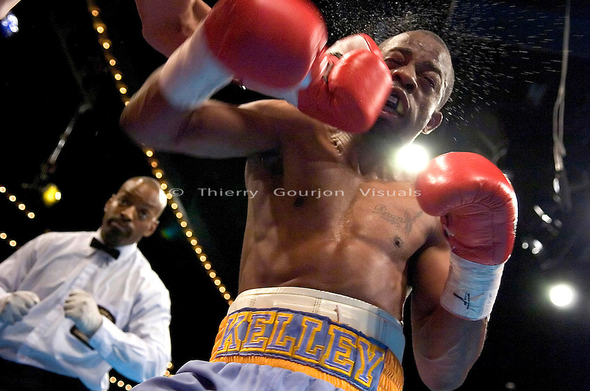 Kevin Kelley (R) is caught by Felix St. Kitts  during their 8 Rounds Jr. Welterweight fight at Madison Square Garden in New York City on March 3rd, 2005. Kelley won the fight by a 8th round TKO.
