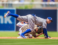 23 June 2013: Los Angeles Dodgers infielder Nick Punto turns a double-play on a sliding Logan Forsythe during game action against the San Diego Padres at Petco Park in San Diego, California. The Dodgers defeated the Padres 3-1, splitting their 4-game Divisional Series at 2-2. Mandatory Credit: Ed Wolfstein Photo *** RAW (NEF) Image File Available ***