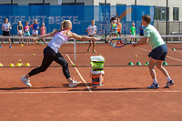Amstelveen, Netherlands, 22 june 2020, NTC, National Tennis Center, Book presentation with Kiki Bertens, Kiki and Demi Schuurs (R) playing tennis with some kids