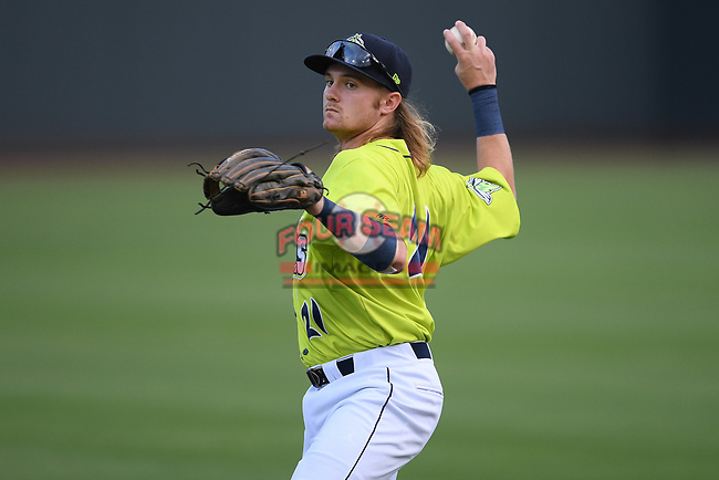 Second baseman Nick Conti (21) of the Columbia Fireflies warms up before a game against the Hickory Crawdads on Tuesday, August 27, 2019, at Segra Park in Columbia, South Carolina. Columbia won, 3-2. (Tom Priddy/Four Seam Images)