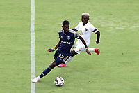 CARY, NC - AUGUST 01: Hadji Barry #92 is chased by Anderson Asiedu #6 during a game between Birmingham Legion FC and North Carolina FC at Sahlen's Stadium at WakeMed Soccer Park on August 01, 2020 in Cary, North Carolina.