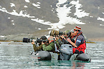 Tourists / photographers photographing polar bears. Woodfjorden, northern Spitsbergen, Svalbard, Arctic Norway.