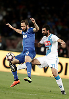 Calcio, Serie A: Napoli, stadio San Paolo, 2 aprile, 2017.<br /> Napoli's Raul Albiol (r) in action with Juventus Gonzalo Higuain (l) during the Italian Serie A football match between Napoli and Juventus at San Paolo stadium, April 2, 2017<br /> UPDATE IMAGES PRESS/Isabella Bonotto