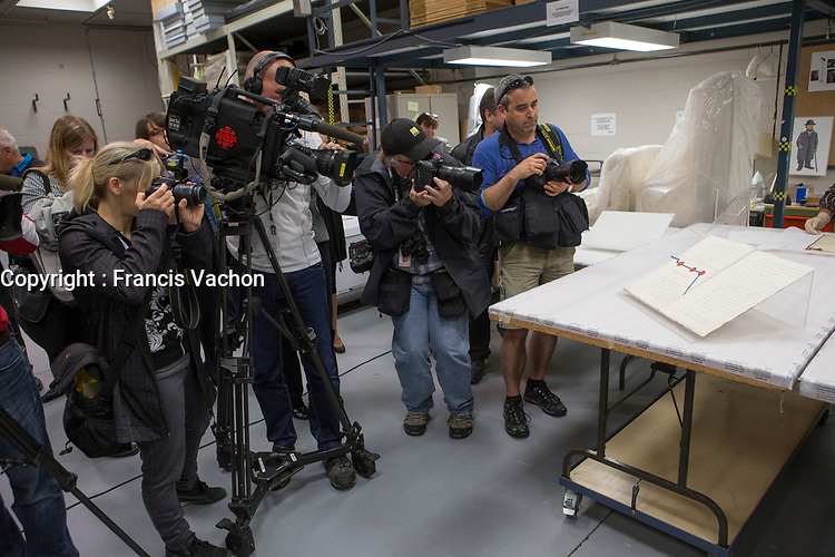 Journalists document the unboxing of the Traite de Paris de 1763 (Treaty of Paris of 1763) before an exhibition in Quebec City, septembre 22 2014. The Treaty of Paris, also known as the Treaty of 1763, was signed on 10 February 1763 by the kingdoms of Great Britain, France and Spain, with Portugal in agreement, after Britain's victory over France and Spain during the Seven Years' War.<br /> <br /> PHOTO :  Francis Vachon - Agence Quebec Presse