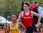 WINSTED, CT 051121JS08—Northwestern's Chris Ferrarotti keeps pace with Thomaston's Kian Reyes while running their leg of the 4x800 meter relay during their meet Tuesday at Northwestern Regional High School. <br /> Jim Shannon Republican American