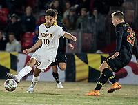 COLLEGE PARK, MD - NOVEMBER 21: Ben Di Rosa #25 of Maryland moves in on Najim Romero #10 of Iona during a game between Iona College and University of Maryland at Ludwig Field on November 21, 2019 in College Park, Maryland.