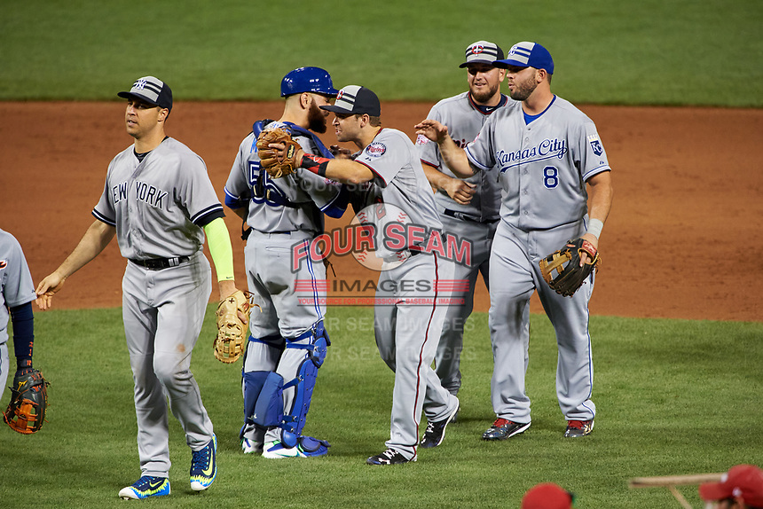 Minnesota Twins Brian Dozier hugs Toronto Blue Jays catcher Russell Martin along with Kansas City Royals Mike Moustakas and Minnesota Twins Glenn Perkins after closing out the MLB All-Star Game on July 14, 2015 at Great American Ball Park in Cincinnati, Ohio.  New York Yankees Mark Teixeira is to left.  (Mike Janes/Four Seam Images)