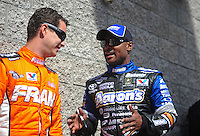 Apr. 1, 2012; Las Vegas, NV, USA: NHRA top fuel dragster driver Antron Brown (right) talks with teammate Spencer Massey during the Summitracing.com Nationals at The Strip in Las Vegas. Mandatory Credit: Mark J. Rebilas-