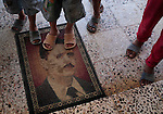Children step on a mat with the image of president Assad at an aid station administered by Free Syrian Army sympathizers in a northern town close to the border with Turkey...Javier Manzano